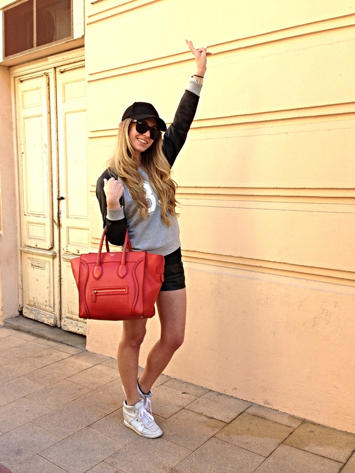 Isabel Marant sneakers, Celine boston bag, short and sweat.
